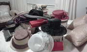 variety of hats and clutch purses